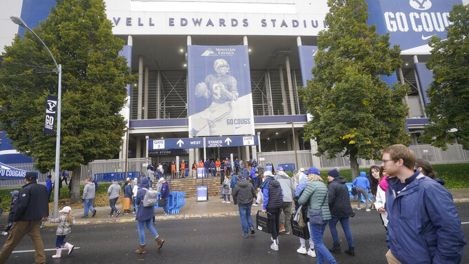 BYU fans arrive at LaVell Edwards Stadium for an NCAA college football game against Boise State, Saturday, Oct. 9, 2021, in Provo, Utah. (AP Photo/Rick Bowmer)