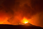 A brush fire burns at the Apple Fire in Banning, Calif., Saturday, Aug. 1, 2020. (AP Photo/Ringo H.W. Chiu)