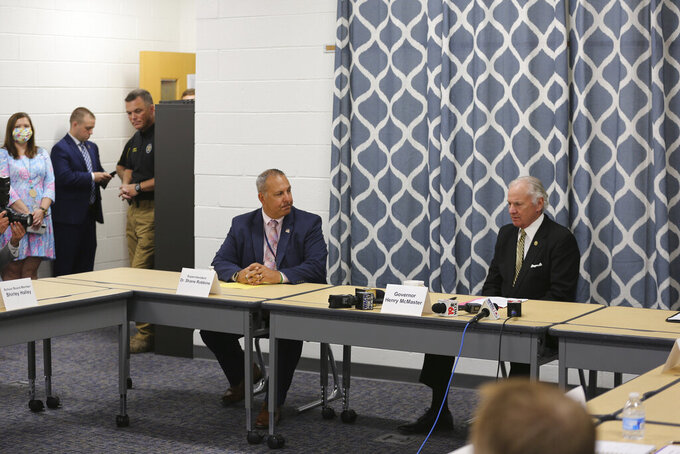 South Carolina Gov. Henry McMaster, right, speaks to Kershaw County school superintendent Shane Robbins, left, during a discussion with school officials about COVID-19 at Camden Elementary School on Wednesday Sept. 15, 2021, in Camden, S.C. Nurses, principals and school board members were part of the roundtable discussion. (AP Photo/Jeffrey Collins)