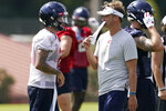 Mississippi football coach Lane Kiffin, right, and quarterback Matt Corral (2) confer during a morning NCAA college football practice on the Oxford, Miss., campus, Monday, Aug. 9, 2021. (AP Photo/Rogelio V. Solis)