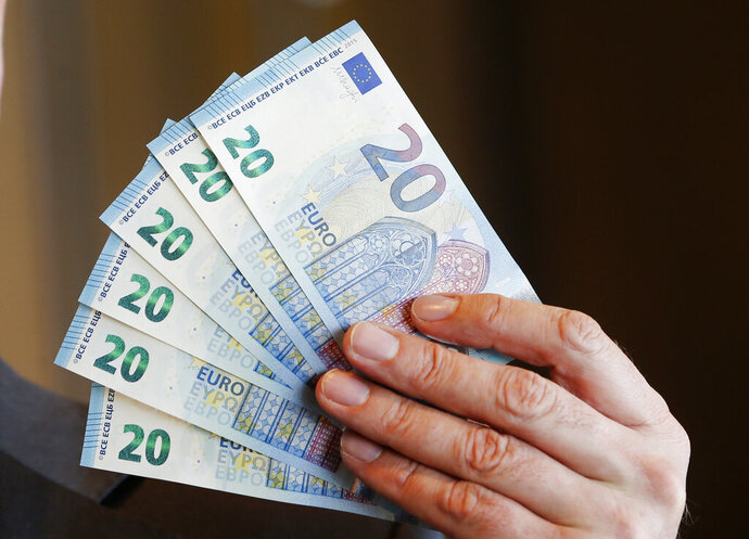 FILE - In this Wednesday, March 4, 2015 file photo, new 20 Euro bank notes are displayed in Frankfurt, Germany. Bulgaria's prime minister says his country still aims to adopt the euro by 2022 despite some opposition by local businesses. Speaking at a business forum in the capital Tuesday, Jan. 29, 2019 Boyko Borissov said that one of the important benefits of Bulgaria's planned accession to the euro will be that the country's banking system will become more disciplined. (AP Photo/Michael Probst, file)