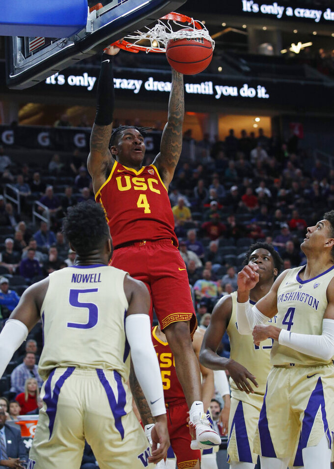 Southern California's Kevin Porter Jr. dunks against Washington during the second half of an NCAA college basketball game in the quarterfinal round of the Pac-12 men's tournament Thursday, March 14, 2019, in Las Vegas. (AP Photo/John Locher)
