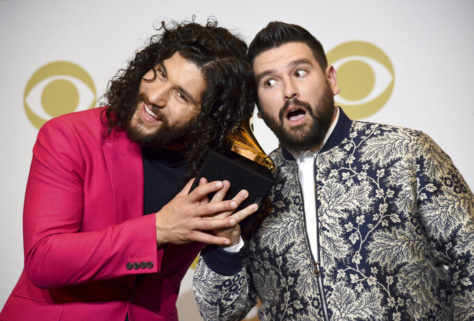 "Dan + Shay pose in the press room with the award for best country duo/group performance for ""Speechless"" at the 62nd annual Grammy Awards at the Staples Center on Sunday, Jan. 26, 2020, in Los Angeles. (AP Photo/Chris Pizzello)"
