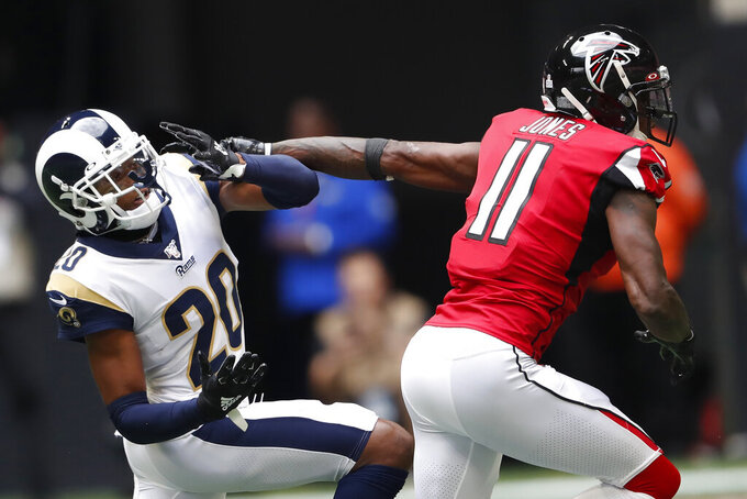 Los Angeles Rams cornerback Jalen Ramsey (20) works against Atlanta Falcons wide receiver Julio Jones (11) during the first half of an NFL football game, Sunday, Oct. 20, 2019, in Atlanta. (AP Photo/John Bazemore)