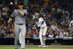 San Diego Padres' Fernando Tatis Jr., center, reacts after hitting a triple as San Francisco Giants starting pitcher Jeff Samardzija, left, catches the ball during the sixth inning of a baseball game, Monday, July 1, 2019, in San Diego. (AP Photo/Gregory Bull)