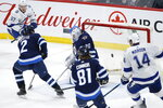 Winnipeg Jets goaltender Laurent Brossoit (30) cannot stop a rebound shot from Tampa Bay Lightning's Alex Killorn (not shown) to give them a in third-period NHL hockey game action in Winnipeg, Manitoba, Friday, Jan. 17, 2020. (John Woods/The Canadian Press via AP)