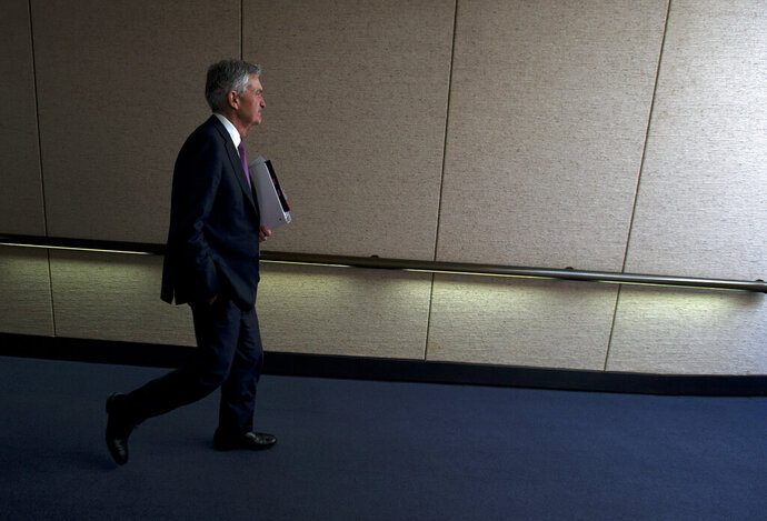 Federal Reserve Board Chair Jerome Powell leaves after the hearing on the economic outlook, on Capitol Hill in Washington, on Wednesday, Nov. 13, 2019. (AP Photo/Jose Luis Magana)