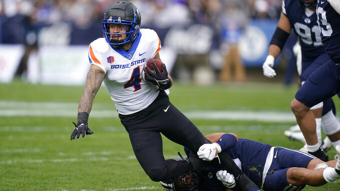 BYU linebacker Chaz Ah You, bottom, tackles Boise State running back Cyrus Habibi-Likio (4) in the first half during an NCAA college football game Saturday, Oct. 9, 2021, in Provo, Utah. (AP Photo/Rick Bowmer)