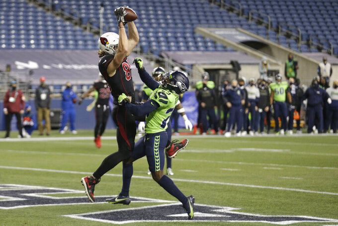 Arizona Cardinals tight end Dan Arnold, left, makes a catch for a touchdown under the defense of Seattle Seahawks defensive back Jayson Stanley, right during second first half of an NFL football game, Thursday, Nov. 19, 2020, in Seattle. (AP Photo/Lindsey Wasson)
