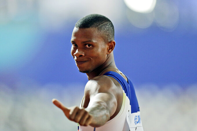 FILE - In this Sept. 29, 2019. file photo, Alex Quiñónez, of Ecuador, gestures after a men's 200 meter heat at the World Athletics Championships in Doha, Qatar.  Olympic sprinter Alex Quiñónez was fatally shot in the port city of Guayaquil in Ecuador on Friday night, Oct. 22, 2021, police said. (AP Photo/Petr David Josek)