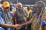 John Momis, left, president of the Autonomous Region of Bougainville, shakes hands with Bougainville MP William Nakin, right, in Buka, Papua New Guinea, Saturday, Nov. 23, 2019, during a historic referendum to decide if they want to become the world's newest nation by gaining independence from Papua New Guinea. (Post Courier via AP)