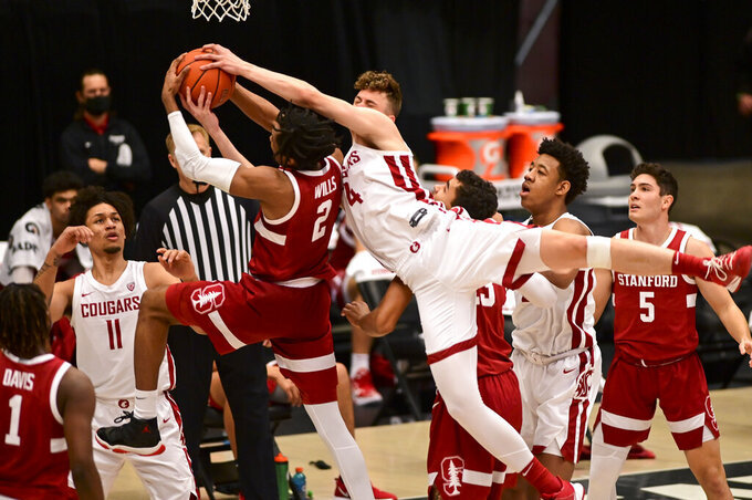Stanford guard Bryce Wills (2) and Washington State forward Aljaz Kunc (4) fight for a rebound during the first half of an NCAA college basketball game, Saturday, Feb. 20, 2021, in Pullman, Wash. (AP Photo/Pete Caster)