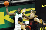Oregon forward Eugene Omoruyi (2) looks to pass as he is defended by Stanford forward Lukas Kisunas (32) during the first half of an NCAA college basketball game Saturday, Jan. 2, 2021, in Eugene, Ore. (AP Photo/Andy Nelson)