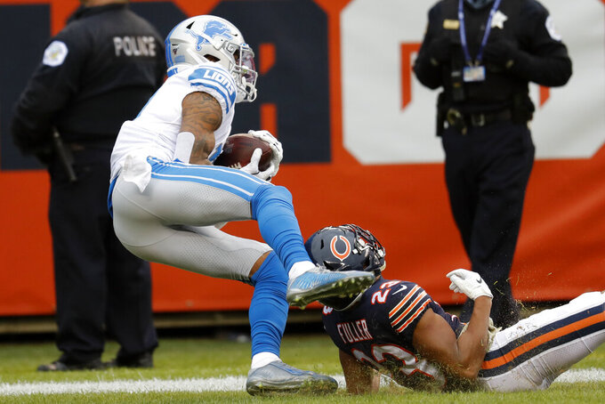 Detroit Lions wide receiver Kenny Golladay, left, catches a 47-yard touchdown pass as Chicago Bears cornerback Kyle Fuller (23) defends during the second half of an NFL football game in Chicago, Sunday, Nov. 10, 2019. (AP Photo/Charles Rex Arbogast)