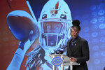 Virginia's Bryce Perkins speaks during the Atlantic Coast Conference NCAA college football media days in Charlotte, N.C., Thursday, July 18, 2019. (AP Photo/Chuck Burton)
