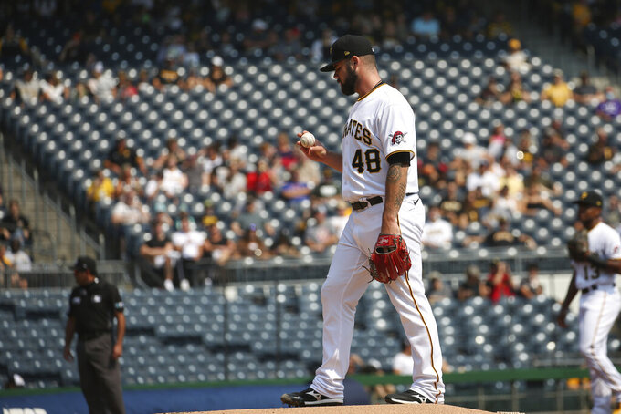 Pittsburgh Pirates starter Bryse Wilson prepares to pitch in the first inning during a baseball game against the Washington Nationals, Sunday, Sept. 12, 2021, in Pittsburgh. (AP Photo/Rebecca Droke)