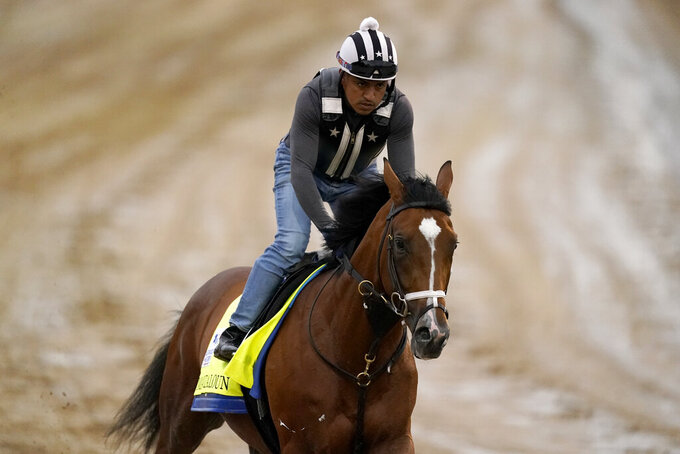 FILE - In this April 29, 2021, file photo, Kentucky Derby entrant Mandaloun works out at Churchill Downs in Louisville, Ky. Mandaloun is slated to run in the Haskell on Saturday, July 17, 2021, at Monmouth Park in Oceanport, N.J.  (AP Photo/Charlie Riedel, File)