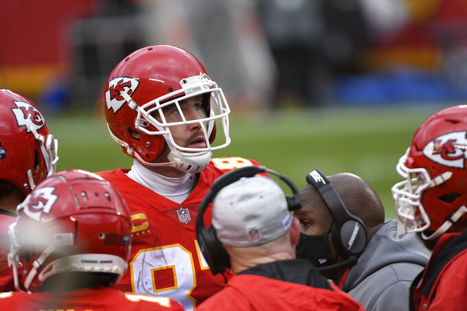 Kansas City Chiefs tight end Travis Kelce stands on the sideline during the first half of an NFL divisional round football game against the Cleveland Browns, Sunday, Jan. 17, 2021, in Kansas City. (AP Photo/Reed Hoffmann)