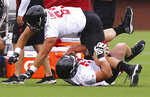 Atlanta Falcons first round draft picks, offensive linemen Chris Lindstrom, top, and Kaleb McGary, get tangled up and fall while racing each other across the field to the next drill during NFL football practice in Flowery Branch, Ga., Wednesday, June 2, 2019. (Curtis Compton/Atlanta Journal-Constitution via AP)
