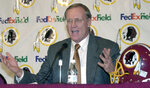 "FILE - In this Jan. 4, 2001, file photo, Washington Redskin's new head coach Marty Schottenheimer speaks at a news conference at Redskins Park in Ashburn, Va. Marty Schottenheimer, who won 200 regular-season games with four NFL teams thanks to his ""Martyball"" brand of smash-mouth football but regularly fell short in the playoffs, has died. He was 77. Schottenheimer died Monday night, Feb. 8, 2021,  at a hospice in Charlotte, North Carolina, his family said through Bob Moore, former Kansas City Chiefs publicist. (AP Photo/Stephen J. Boitano, FIle)"