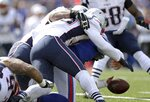 Buffalo Bills quarterback Josh Allen fumbles as he is tackled by New England Patriots linebacker Kyle Van Noy in the first half of an NFL football game, Sunday, Sept. 29, 2019, in Orchard Park, N.Y. The Bills recovered the fumble. (AP Photo/Ron Schwane)