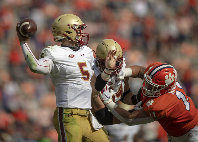 Boston College quarterback Phil Jurkovec (5) passes the ball near Clemson defensive lineman Bryan Bresee (11) during the first half of an NCAA college football game Saturday, Oct. 31, 2020, in Clemson, S.C. (Josh Morgan/Pool Photo via AP)