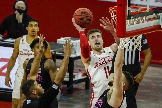 Wisconsin's Micah Potter shoots during the second half of an NCAA college basketball game against Penn State Tuesday, Feb. 2, 2021, in Madison, Wis. (AP Photo/Morry Gash)