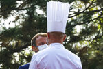 French President Emmanuel Macron is welcomed by chef Jerome Bocuse as he arrives to visit the International Catering, Hotel and Food Trade Fair (SIRHA) in Lyon, central France, Monday Sept. 27, 2021.(Denis Balibouse/Pool via AP)