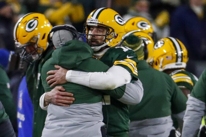 Green Bay Packers head coach Matt LaFleur celebrates a touchdown with Aaron Rodgers during the second half of an NFL divisional playoff football game against the Seattle Seahawks Sunday, Jan. 12, 2020, in Green Bay, Wis. (AP Photo/Matt Ludtke)