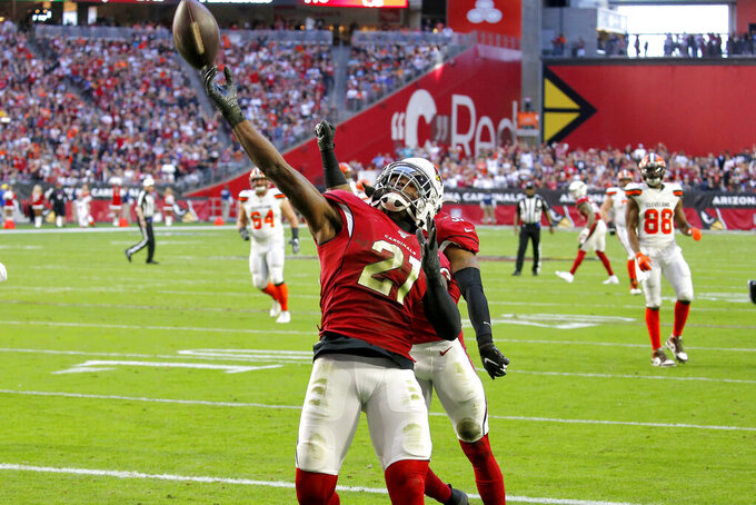 Arizona Cardinals cornerback Patrick Peterson (21) celebrates his interception in the end zone against the Cleveland Browns during the first half of an NFL football game, Sunday, Dec. 15, 2019, in Glendale, Ariz. (AP Photo/Ross D. Franklin)