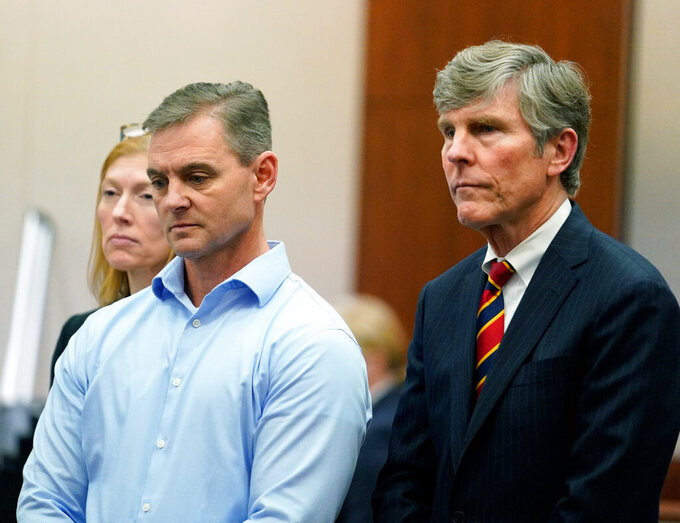 FILE - In this Feb. 27, 2020, file photo, Leslie Comardelle, former Arkema plant manager in Crosby, Texas, left and his defense attorney Paul Nugent, right, stand during the Arkema Inc. criminal trial at Harris County Criminal Courthouse in Houston. State Judge Belinda Hill on Thursday, Oct. 1, 2020, ruled prosecutors had failed to present sufficient evidence to support the charges against Pennsylvania-based Arkema Inc. and ex-plant manager Leslie Comardelle. ( Melissa Phillip/Houston Chronicle via AP, File)