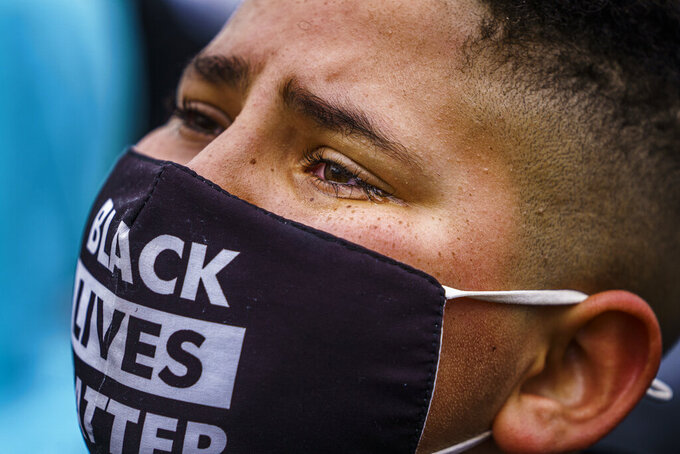 Protesters, including Tristan Love who shed a tear, confronted police over the shooting death of Daunte Wright at a rally at the Brooklyn Center Police Department in Brooklyn Center, Minn., Monday, April 12, 2021. (Richard Tsong-Taatarii/Star Tribune via AP)