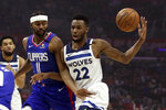 Minnesota Timberwolves guard Andrew Wiggins, right, gets the ball knocked out of his hands by Los Angeles Clippers forward Maurice Harkless, left, driving to the basket during the first half of an NBA basketball game in Los Angeles, Saturday, Feb. 1, 2020. (AP Photo/Alex Gallardo)