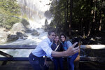 FILE - In a Monday, April 29, 2019 file photo, Democratic presidential candidate and former Texas congressman Beto O'Rourke, left, takes a selfie with Anne Kelly, center, Director of the Sierra Nevada Research Stations and environmental advocate Leslie Martinez, in Yosemite National Park, Calif.  The Democrats who want to be president are swarming California, competing for campaign cash and media attention while courting longtime allies of home-state Sen. Kamala Harris on their rival's own turf. (AP Photo/Marcio Jose Sanchez, File)