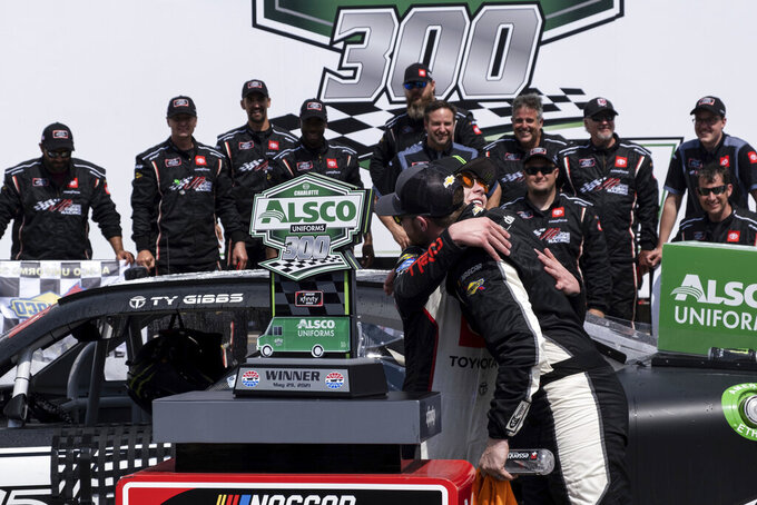 Ty Gibbs, left, gets a hug from fellow driver Ty Dillon after winning the Alsco Uniforms 300 NASCAR Xfinity Series auto race at Charlotte Motor Speedway on Saturday, May 29, 2021 in Charlotte, NC. (AP Photo/Ben Gray)