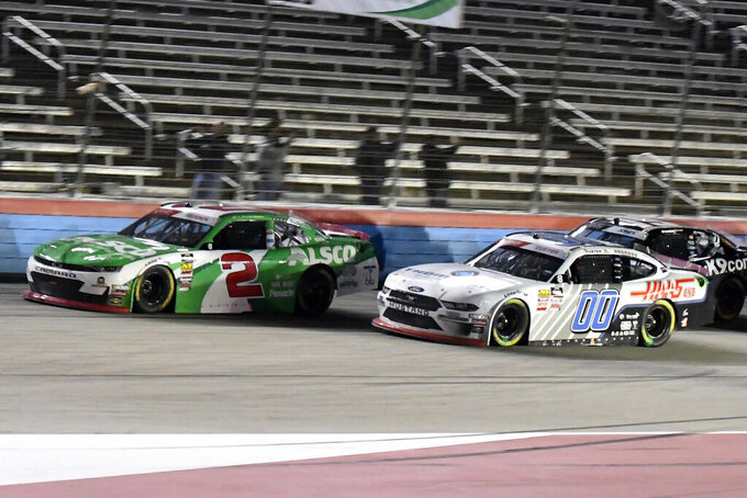 Tyler Reddick (2) and Cole Custer (00) head into the front stretch during the NASCAR Xfinity Series auto race at Texas Motor Speedway in Fort Worth, Texas, Saturday, Nov. 2, 2019. (AP Photo/Randy Holt)