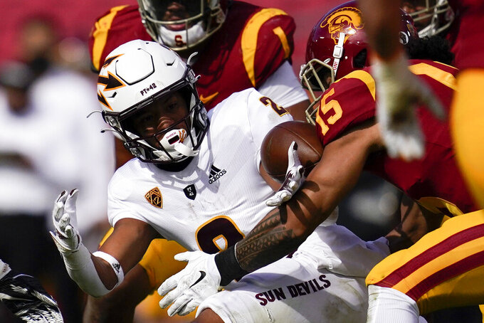 The ball comes loose for a fumble as Arizona State wide receiver LV Bunkley-Shelton (2) is tackled by Southern California safety Talanoa Hufanga (15) during the first half of an NCAA college football game Saturday, Nov. 7, 2020, in Los Angeles. (AP Photo/Ashley Landis)
