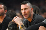 Singer Adam Levine watches the first half of an NBA basketball game between the Los Angeles Lakers and the New Orleans Pelicans on Friday, Jan. 3, 2020, in Los Angeles. (AP Photo/Mark J. Terrill)