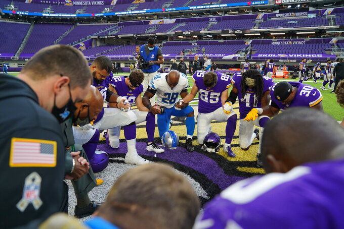 Detroit Lions running back Adrian Peterson (28) praying during a NFL football game against the Minnesota Vikings on Sunday, Nov. 8, 2020 in Minneapolis, MN. The Vikings defeated the Lions 34-20. (Detroit Lions via AP).
