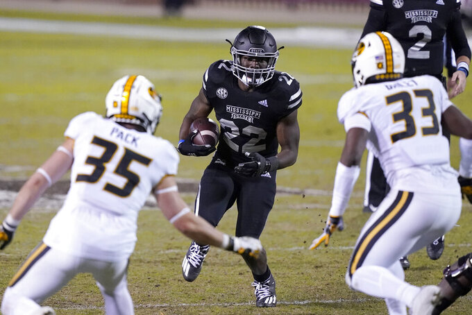 Mississippi State running back Lee Witherspoon (22) rushes upfield as he is pursued by Missouri defensive back Mason Pack (35) and linebacker Chad Bailey (33) during the second half of an NCAA college football game, Saturday, Dec. 19, 2019, in Starkville, Miss. (AP Photo/Rogelio V. Solis)