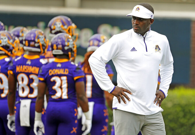 FILE - In this Sept. 8, 2018, file photo, East Carolina coach Scottie Montgomery watches his team before an NCAA college football game against North Carolina in Greenville, N.C. Montgomery was fired Thursday, Nov. 29, and defensive coordinator David Blackwell will lead the team in a game against North Carolina State on Saturday. (AP Photo/Karl B DeBlaker, File)