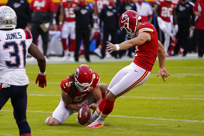 Kansas City Chiefs place kicker Harrison Butker, right, kicks a 23-yard field goal during the first half of an NFL football game against the New England Patriots, Monday, Oct. 5, 2020, in Kansas City. (AP Photo/Jeff Roberson)