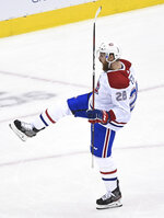 Montreal Canadiens defenseman Jeff Petry (26) celebrates after scoring against the Pittsburgh Penguins during overtime in an NHL hockey playoff game in Toronto, Saturday, Aug. 1, 2020. (Nathan Denette/The Canadian Press via AP)