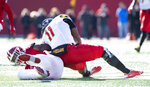 Maryland quarterback Kasim Hill (11) is hit by Indiana linebacker Cam Jones (34), injuring his left leg on the play during the first half of an NCAA college football game Saturday, Nov. 10, 2018, in Bloomington, Ind. (AP Photo/Doug McSchooler)