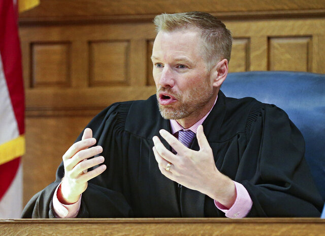 Sixth Judicial District Judge Lars Anderson speaks during a hearing at the Johnson County Courthouse in Iowa City, Iowa, on Wednesday, Sep. 26, 2018. In an opinion released Monday, Sept. 28, 2020, Anderson is refusing to block a Republican-backed Iowa law that makes it harder for county officials to process absentee ballot applications and more likely that incomplete requests won't be fulfilled. (Stephen Mally/The Gazette via AP)