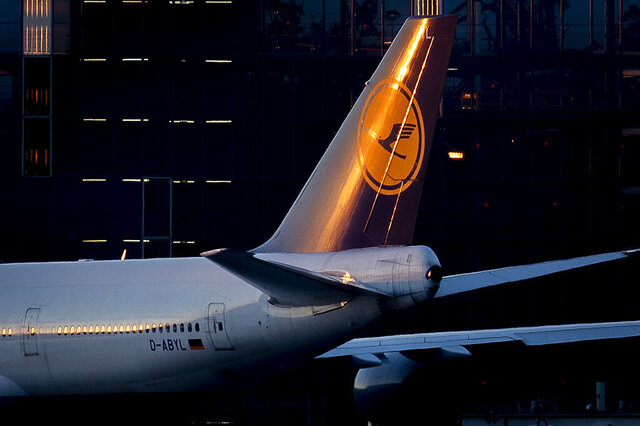 The setting sun illuminates the tail fin of a Lufthansa aircraft at the airport in Frankfurt, Germany, Tuesday, June 23, 2020. The German airline Lufthansa will hold its annual shareholders meeting on Thursday. (AP Photo/Michael Probst)