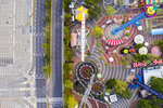 An aerial view shows a closed amusement park and empty road due to the government's measures to help stop the spread of the coronavirus, in Tel Aviv, Israel, Saturday, April 4, 2020. (AP Photo/Oded Balilty)