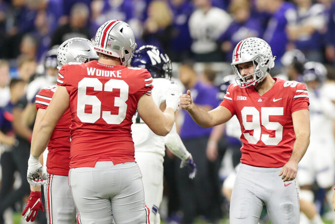 Ohio State place kicker Blake Haubeil (95) is congratulated on a 42-yard field goal by Kevin Woidke (63) during the first half of the Big Ten championship NCAA college football game against Northwestern, Saturday, Dec. 1, 2018, in Indianapolis. (AP Photo/AJ Mast)