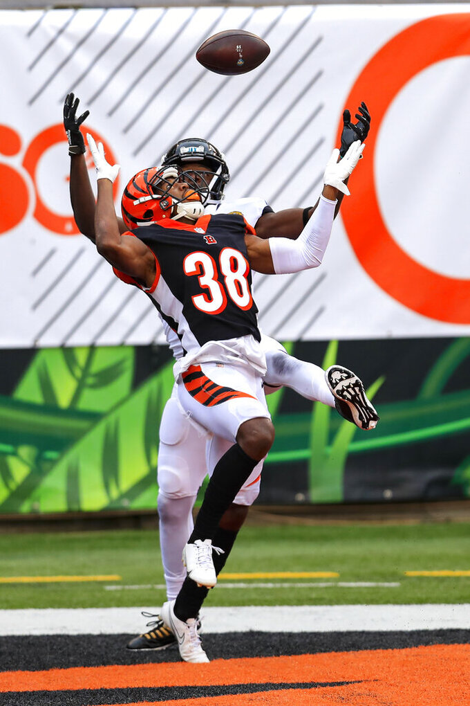 Cincinnati Bengals cornerback LeShaun Sims (38) breaks up a pass intended for Jacksonville Jaguars wide receiver Chris Conley (18) in the second half of an NFL football game in Cincinnati, Sunday, Oct. 4, 2020. (AP Photo/Aaron Doster)