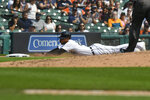 Detroit Tigers' Victor Reyes slides safely into third base on a single from Akil Baddoo in the fifth inning of a baseball game against the Tampa Bay Rays, Sunday, Sept. 12, 2021, in Detroit. (AP Photo/Jose Juarez)
